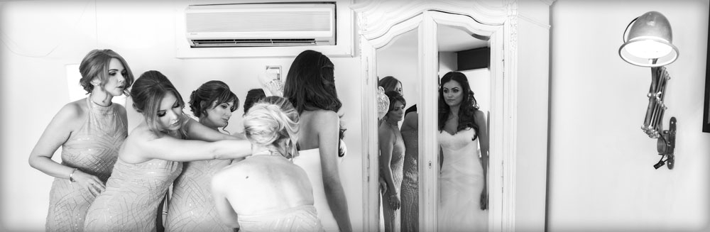 bride getting dressed in the mirror, manchester wedding photographer, Great John Street Hotel