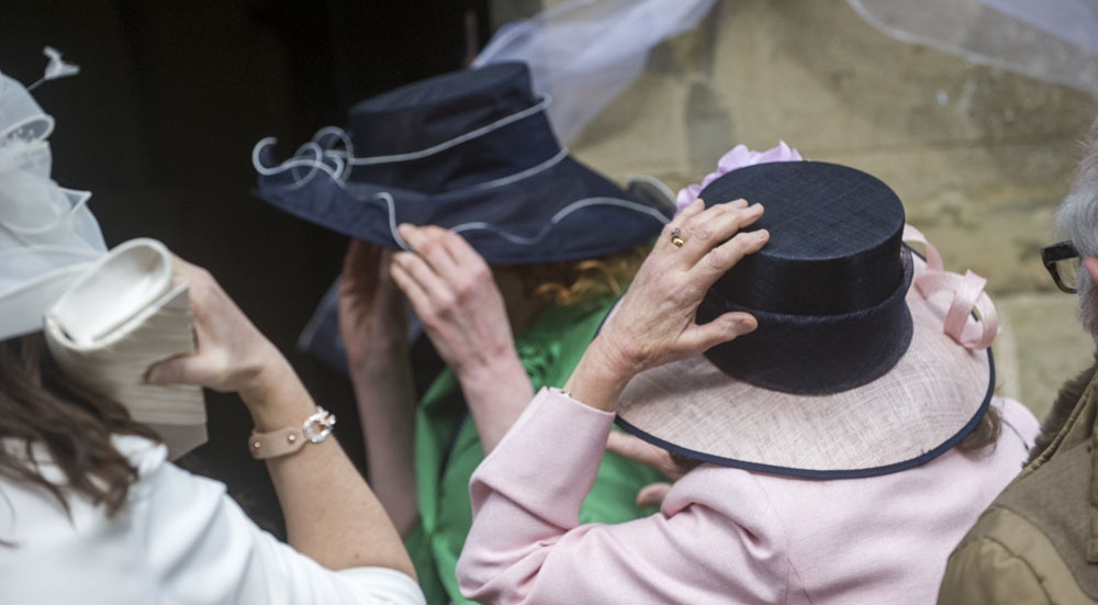 guest almost losing her hat, warwickshire wedding photographer, Ansty Hall