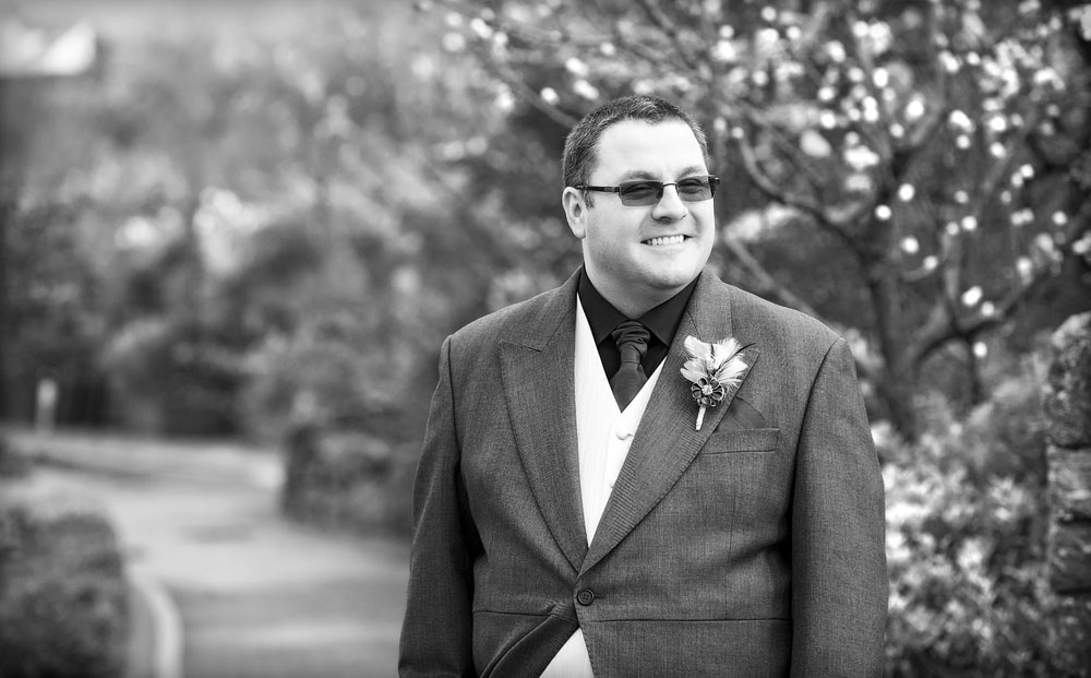 black and white groom in sunglasses, wedding photographer in wales