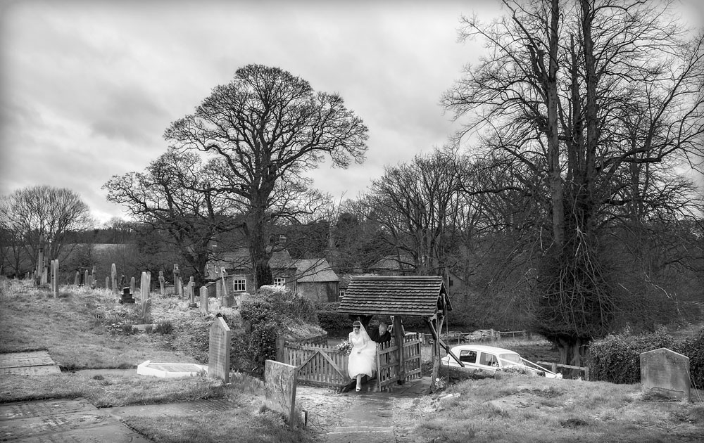 black and white bride arriving church gate, cheshire wedding photographer