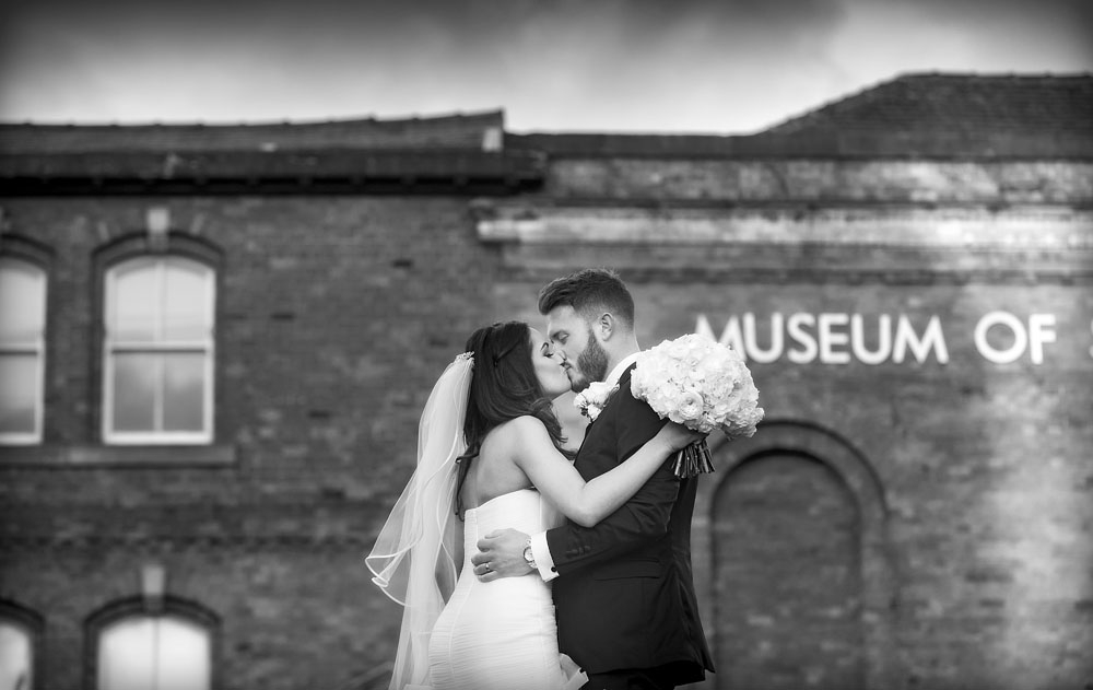 bride and groom kiss, science museum, manchester wedding photographer, Great John Street Hotel