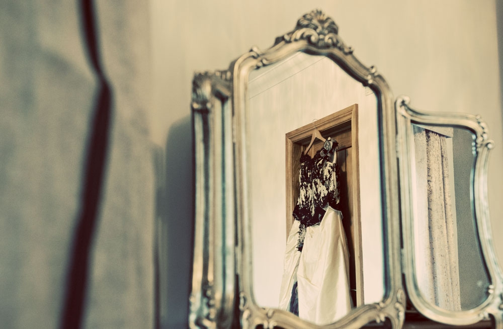 wedding photographer in wales, mirror shot of dress hanging