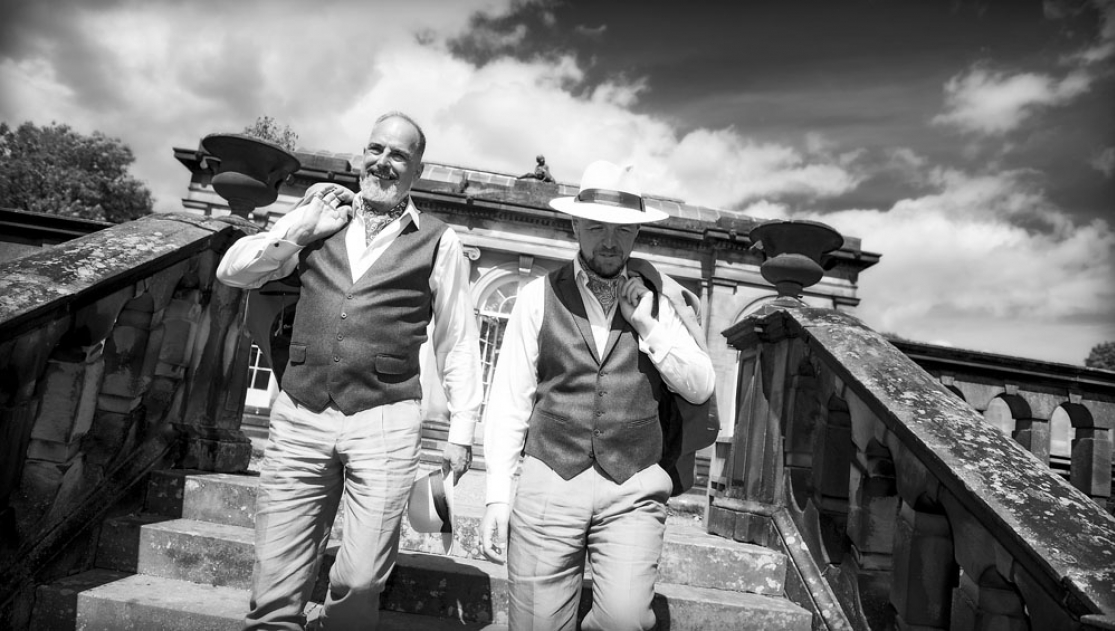 black and white grooms holding hands, staffordshire wedding photographer, heath house weddings