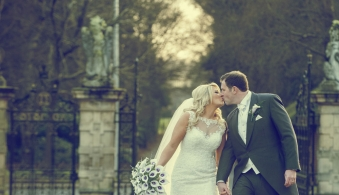 bride and groom kissing, walking up a driveway, cheshire wedding photographer, crewe hall