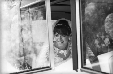 black and white white getting out of vintage car, staffordshire wedding photographer, heath house weddings