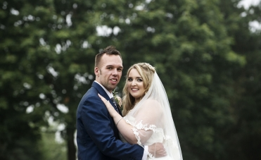 bride and groom looking at camera, staffordshire wedding photographer, alrewas hayes weddings