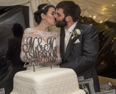 bride and groom cutting the cake, cheshire wedding photographer
