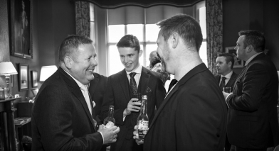 black and white groom and best man laughing, staffordshire wedding photographer, heath house weddings
