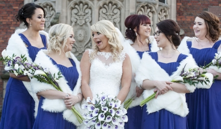 bride laughing with her bridesmaids, cheshire wedding photographer, crewe hall