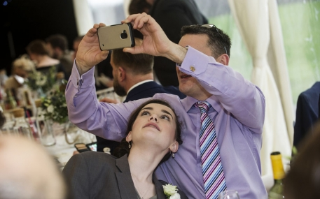 guest taking a photo on a smartphone, cheshire wedding photographer