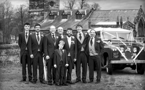 black and white groom and best man and land rover defender, cheshire wedding photographer