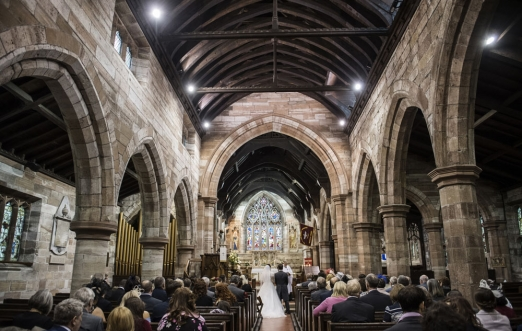 bride and groom saying vows in church, cheshire wedding photographer