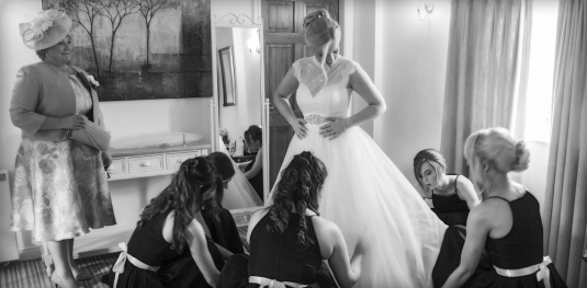 black and white bride in her dress with bridesmaids, cheshire wedding photographer, sandhole oak barn