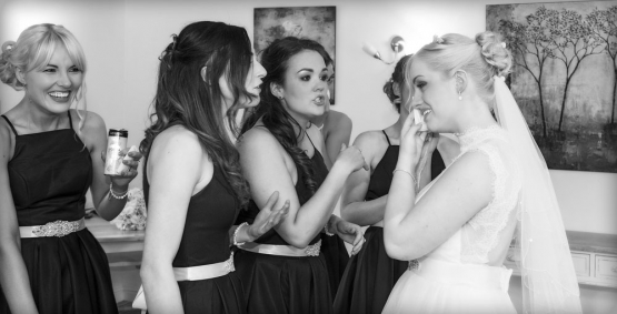 black and white bride and bridesmaids crying tears of joy, cheshire wedding photographer, sandhole oak barn