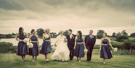 bride, groom, best man and bridesmaids in a line, cheshire wedding photographer, sandhole oak barn