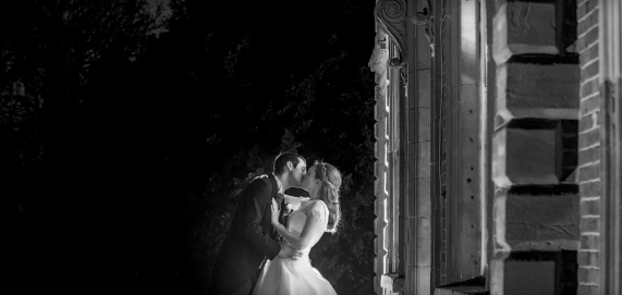 black and white bride and groom kissing, warwickshire wedding photographer, Ansty Hall