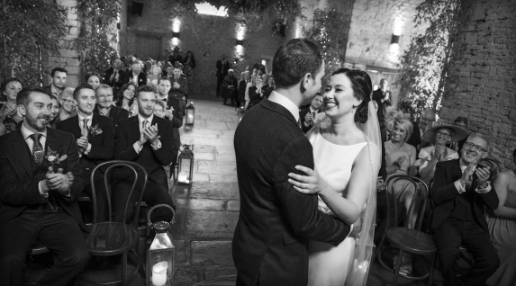 black and white bride and groom first kiss, gloucestershire wedding photographer, cripps barn