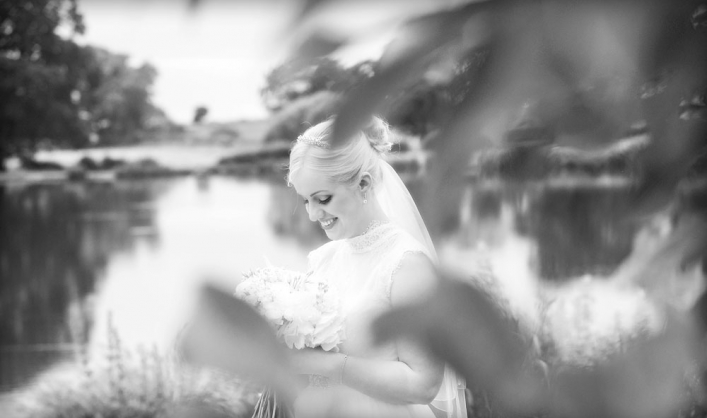 black and white, bride holding her bouquet, cheshire wedding photographer, sandhole oak barn