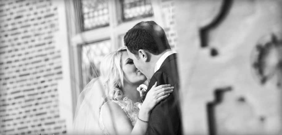 bride and groom kissing, black and white, cheshire wedding photographer, crewe hall