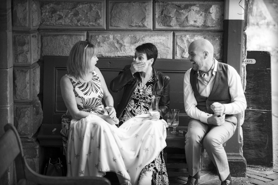 black and white groom and guests laughing, alton station, staffordshire wedding photographer, heath house weddings